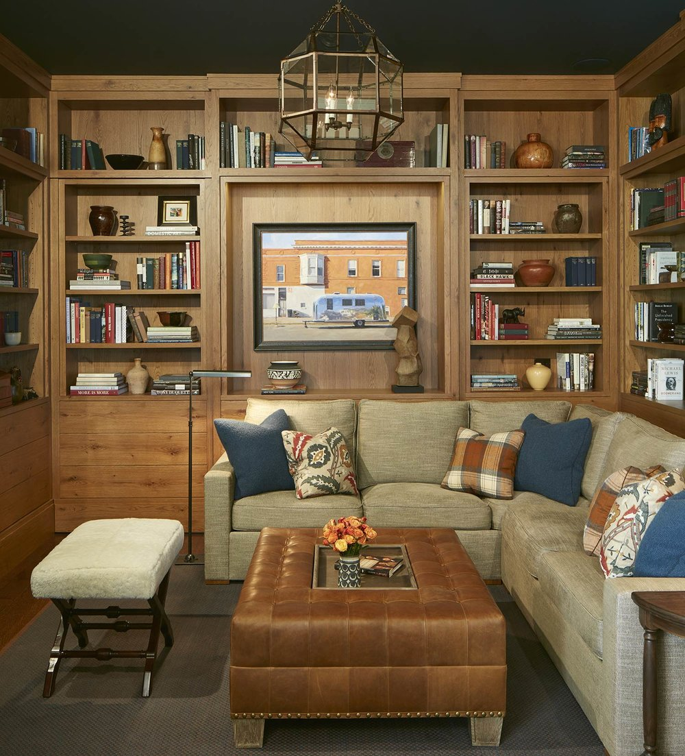 throw pillows & custom ottoman  Interior Design: Bruce Fox, Inc.