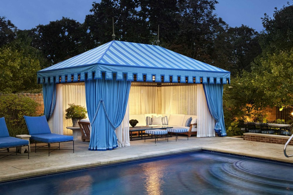 cabana covering, drapery panels, throw pillows, custom upholstery for exterior use  Interior Design: Bruce Fox, Inc.