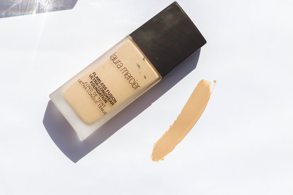 5. Laura Mercier -Flawless Fusion - This is my go-to foundation for a fuller coverage finish on my face. It feels like silk and goes on just as easy. This is the foundation that I use the above brush with.