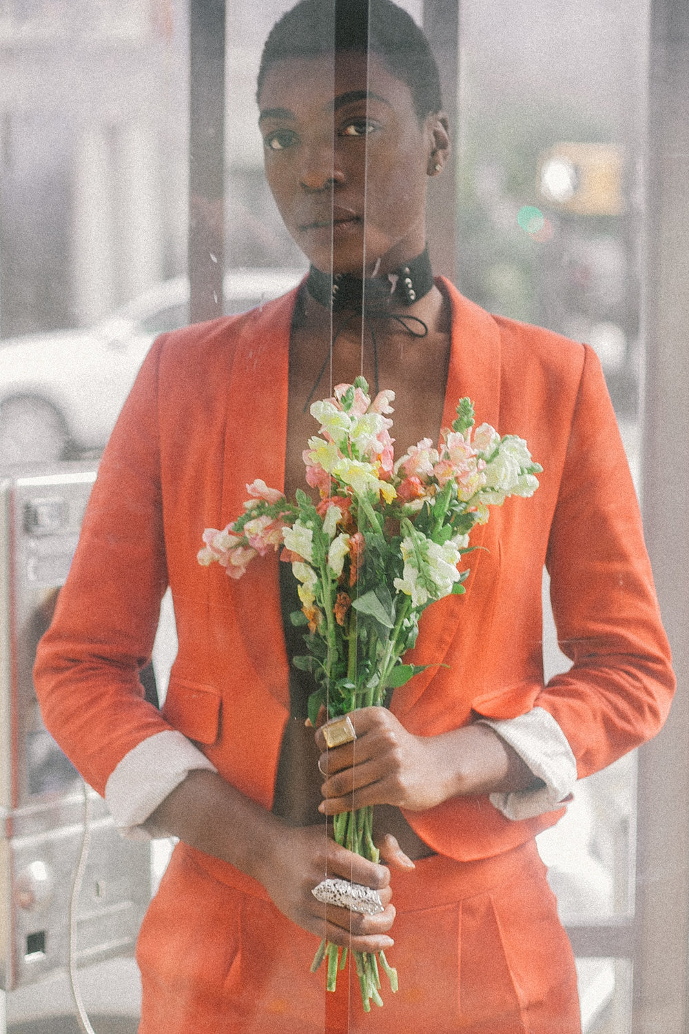 Personal Portrait Photography of model in orange suit captured by Jarrod Anderson
