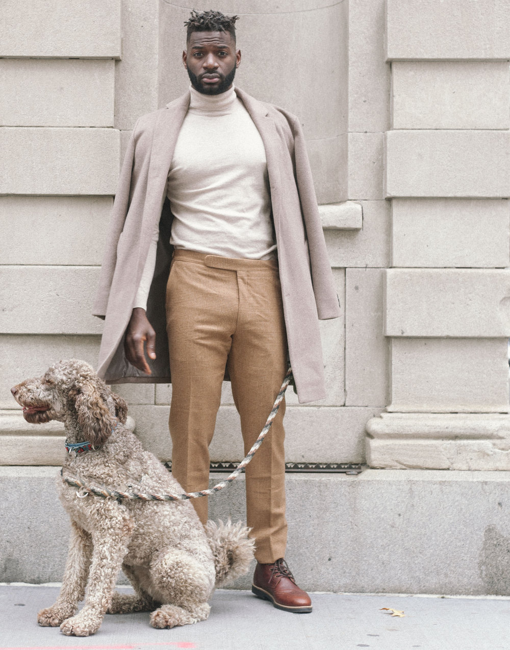 male model fashion photography with a brown dog. captured by jarrod anderson