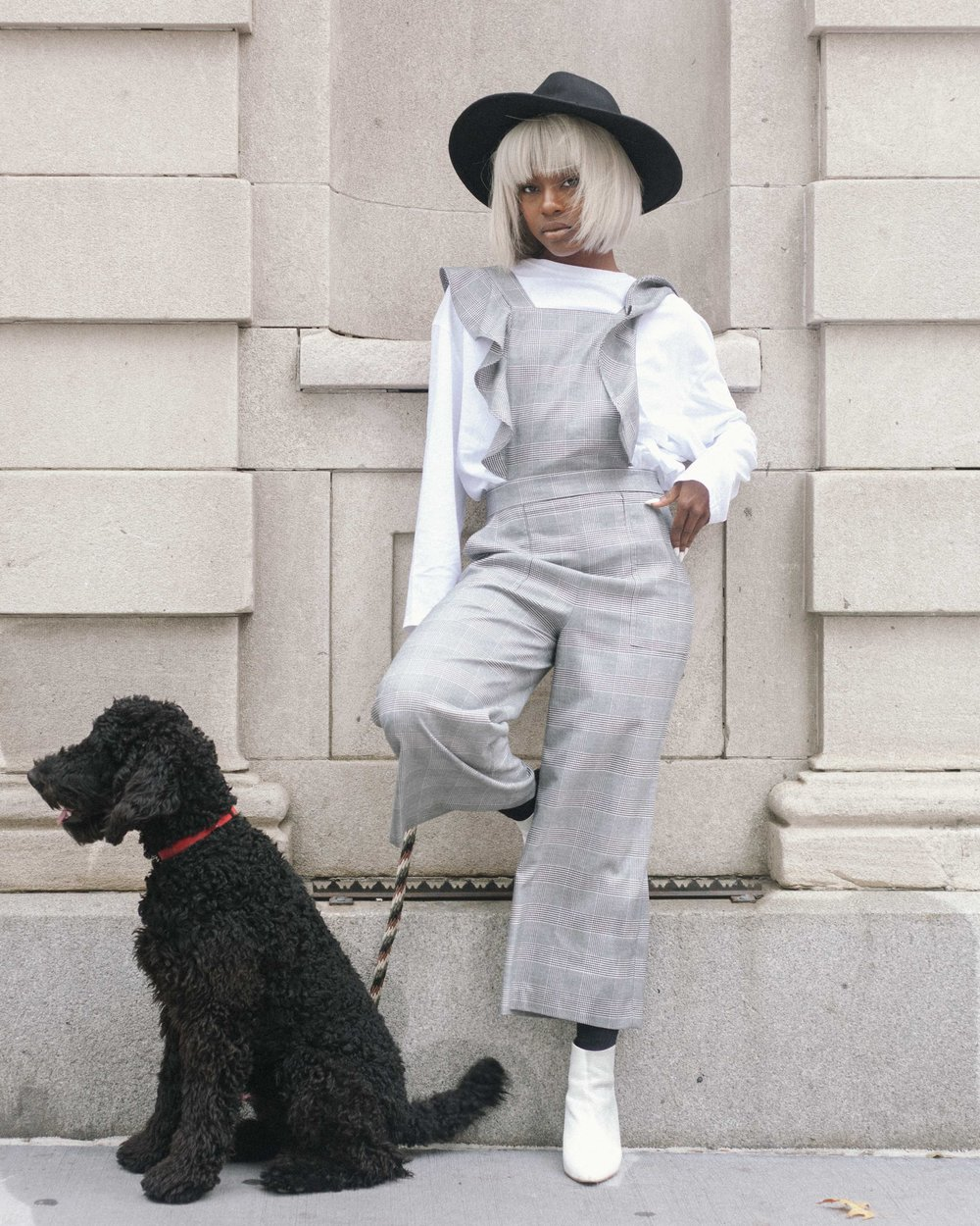 female model fashion photography with a black dog. captured by jarrod anderson in nyc.