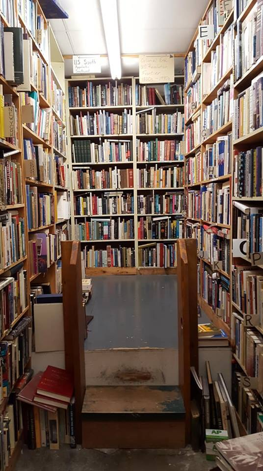 Bookshelves surrounding a small stage