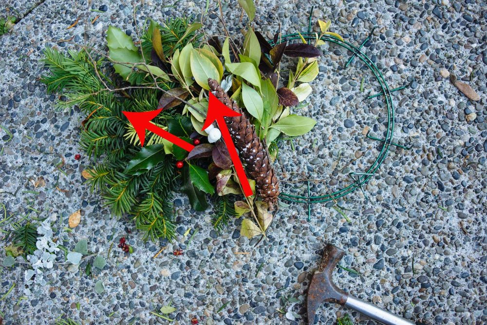 Lay bouquet 2 diagonally facing inward. Hammer down spikes. Repeat all the way around.