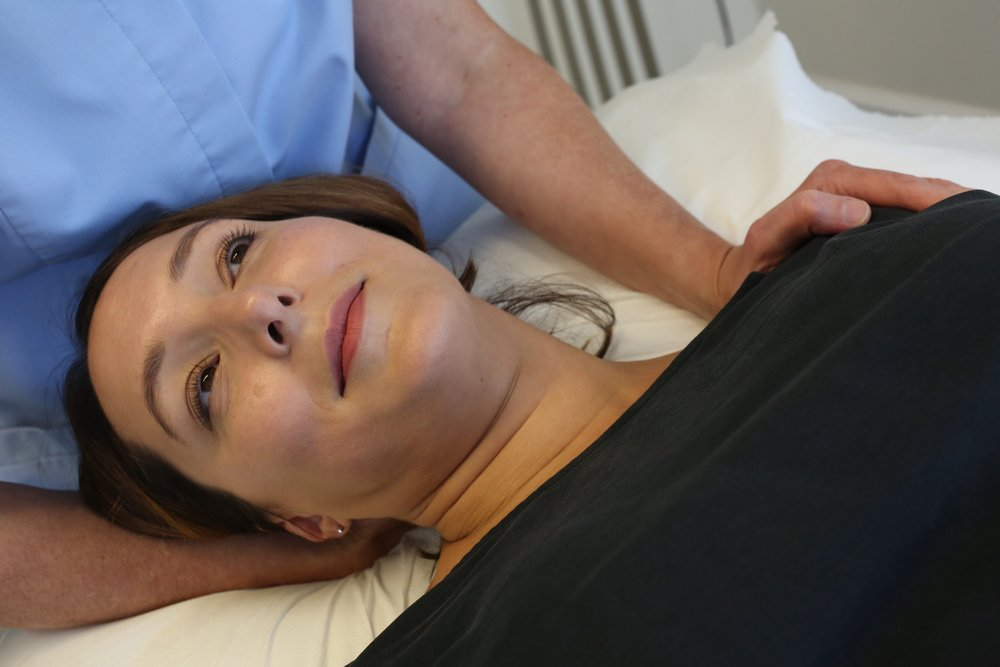 treatment female laying down face2.jpg
