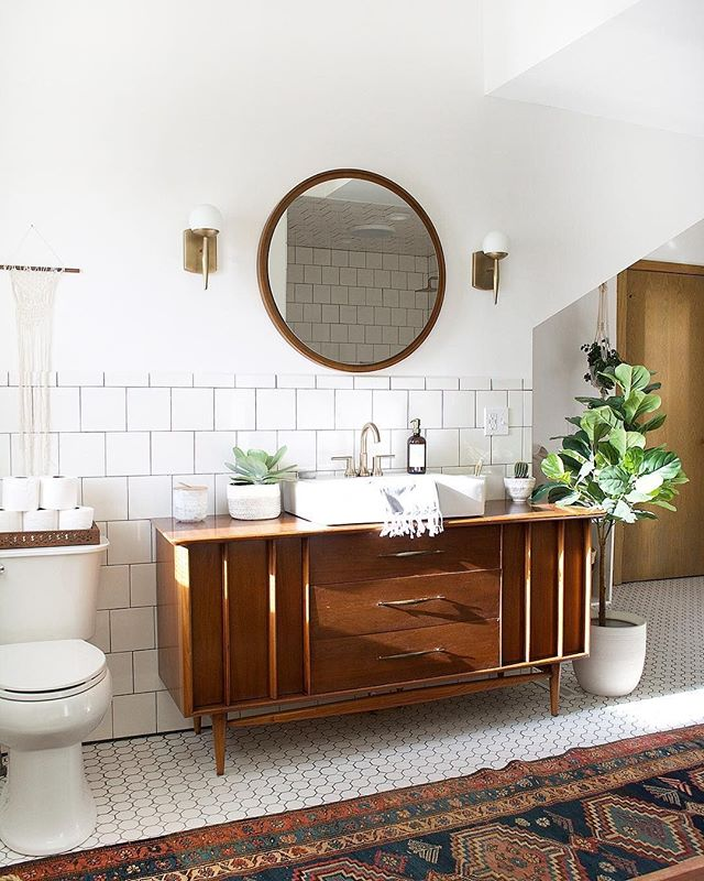 Say hello to this pretty bathroom space from @brepurposed. That subway tile is working wonders here. #homestorydesigns
