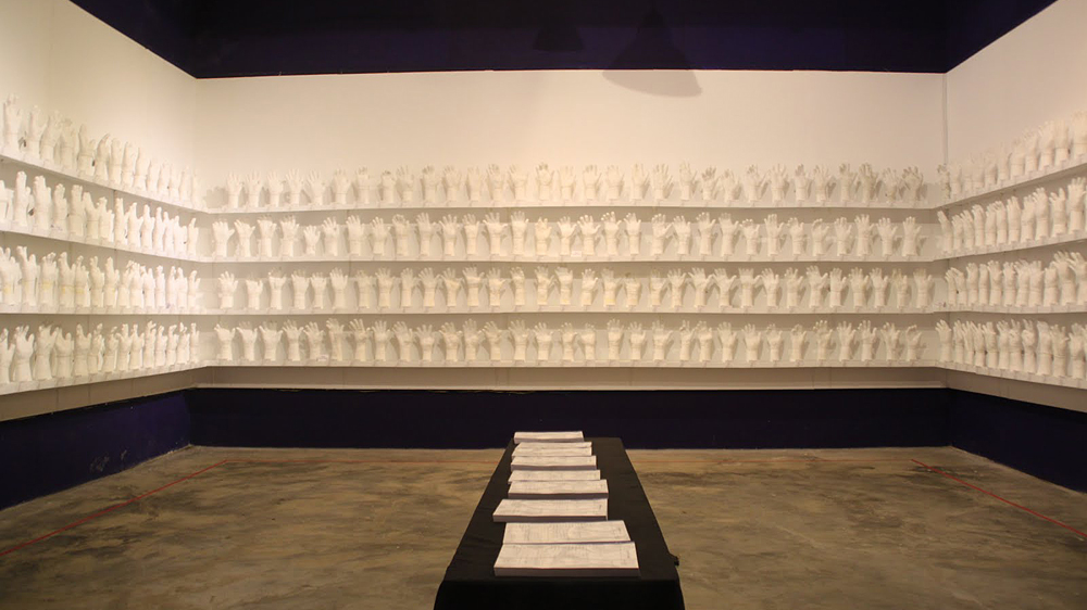 "- Retuning to Myanmar after a few years in London has had an impact on Htein Lin's work, leading to a reconnection with community. His creative practice is very much based on community and collaborations. One such example is ""Show of hands"", a project in which Htein Lin worked with more than 400 former political prisoners in order to make a plaster cast of their hand and arm and record their experiences. We are excited to be screening a video made by the artist which documented the process of seeing this project come to fruition and its respective impact."