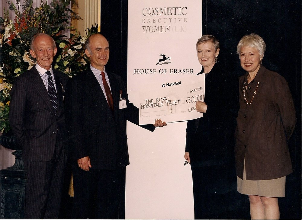 Liz Tilberis Editor-in-Chief Harpers Bazaar US Presents a Cheque to David McClean Consultant Surgeon at The Royal Hospital NHS Trust, 1998