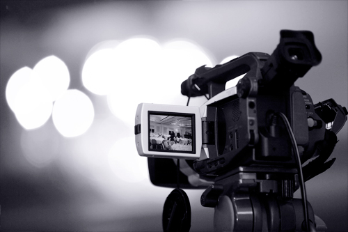 camera filming an event