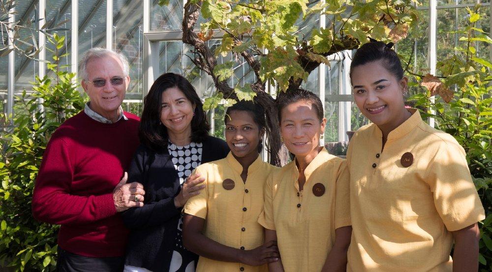 Kamalayas founders, John and Karina Stewart, posing with therapists.