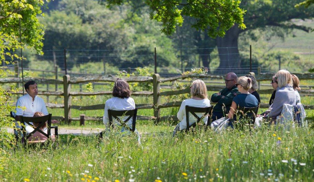 Meditation group session taking place at the Kamalaya Lime Wood retreat