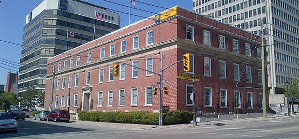 Parking is available behind the building at 10 Duke Street West in Kitchener
