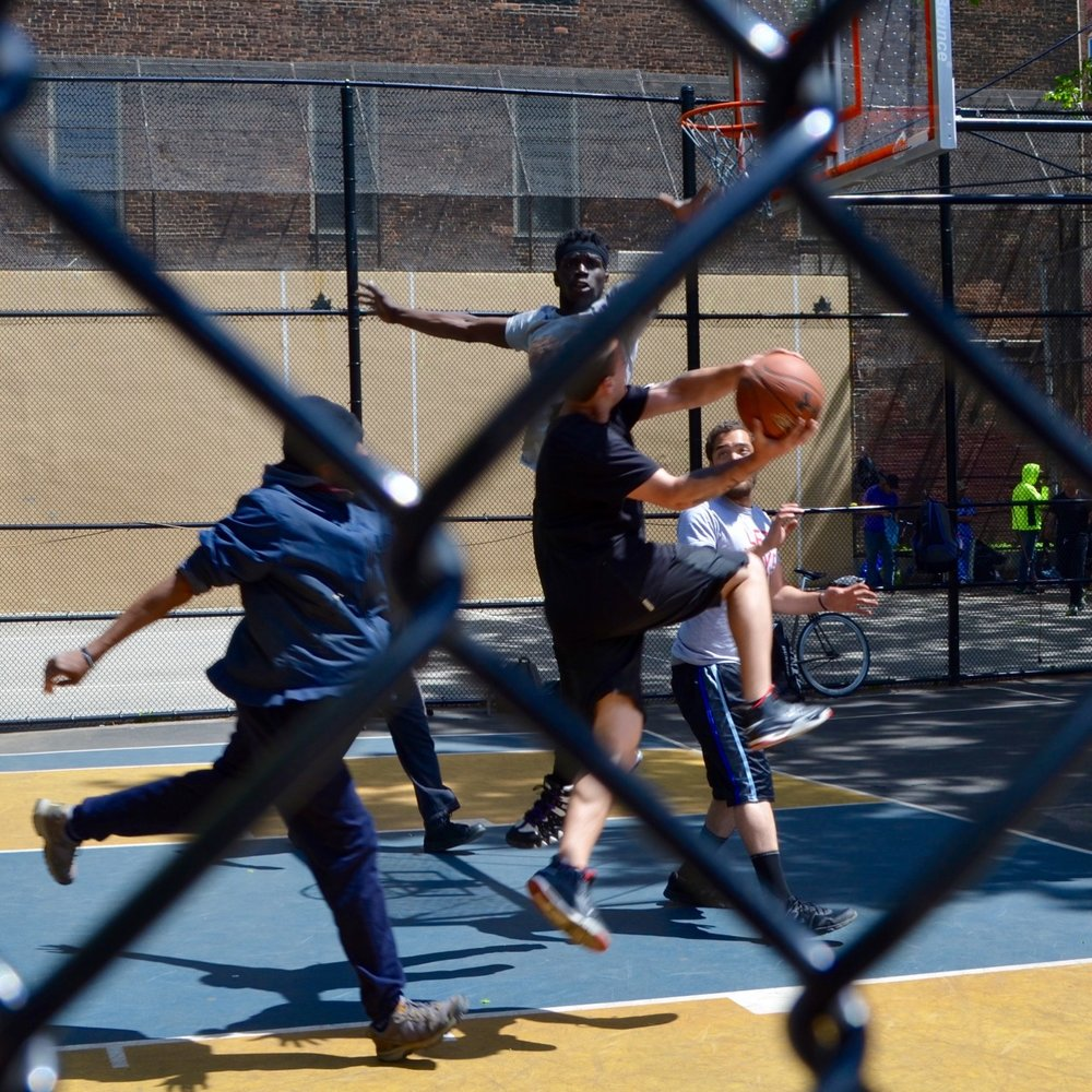 """The Cage"" basketball court in the Village is half of regulation size. Because it's so compact, the streetball gets physical, fast and intense."