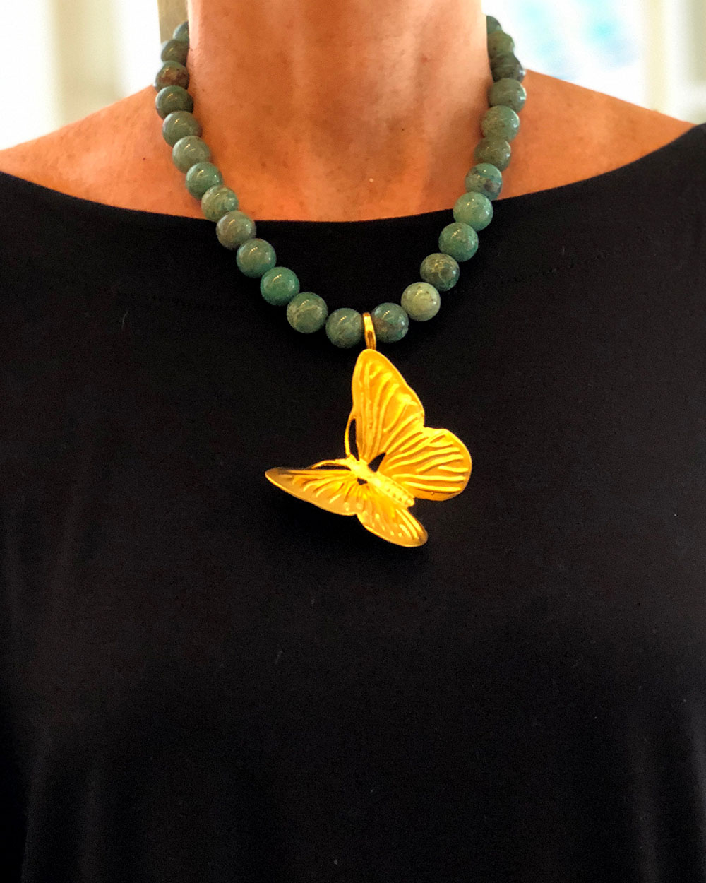 a-home-summit-tommy-mitchell-butterfly-necklace.jpg