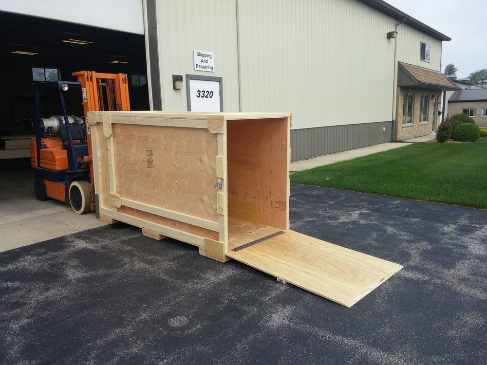 crate with hinged ramp that doubles as the door! brilliant! - No, we didn't invent the concept. But we do make it look good.