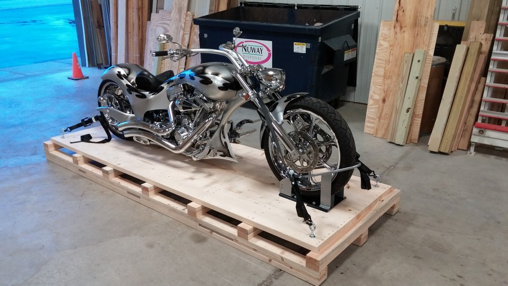 Motorcycle crate bases - This is the base that we use for our motorcycle crates. Trust that your machine will arrive safely sitting on this well-built heavy duty pallet with front wheel chock and tie downs installed.