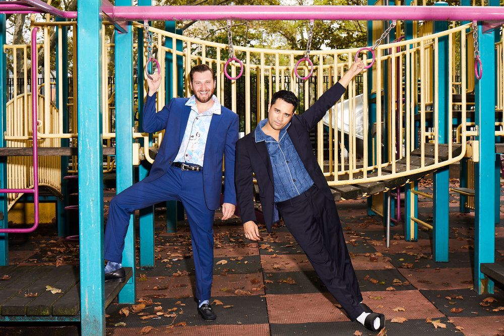 Lawrence wears the    Jetsetter Stretch Italian Wool Suit (Brilliant Navy)    and the    Thaddeus x Bonobos Cabana Shirt (Blue Seashore Seagulls)   , James wears the    Jetsetter Stretch Italian Wool Suit (Light Navy)    and the    Thaddeus x Bonobos Cabana Shirt (Navy Windowpane)