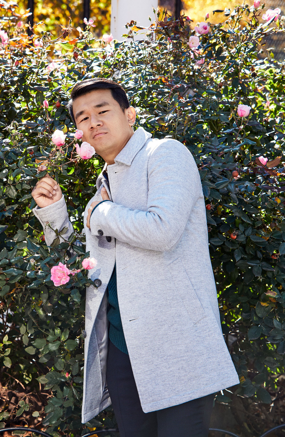 Ronny, a rose among roses, wears the    Italian Wool Car Coat (Textured Light Grey)   , the    Stretch Wool Dress Pants (Navy Stripe)   , and the    Cotton Cashmere Raglan Sweater (Ocean Teal)
