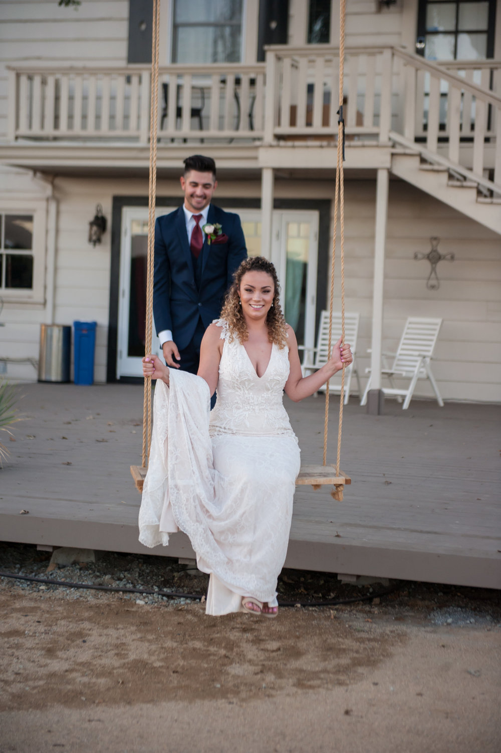 jen vazquez wedding photography Fitz place bride on swing