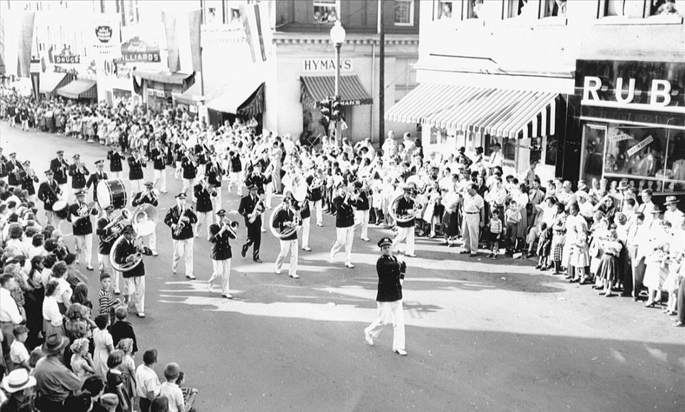 "The Charlottesville Municipal Band entertains parade goers as they march in the Apple Harvest Parade in the early 1950s.  (Courtesy Russell ""Rip"" Payne Collection / Albemarle Charlottesville Historical Society.)"