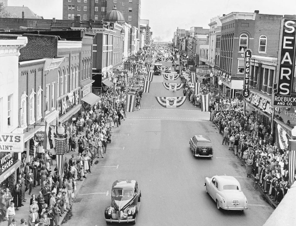 The crowds lining the sides of Main Street are anxiously awaiting the start of the Apple Harvest Parade in 1952.  (Courtesy Ed Roseberry.)