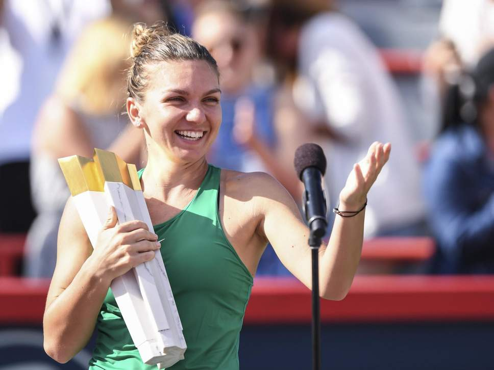 Simona Halep accepting her Rogers Cup trophy.