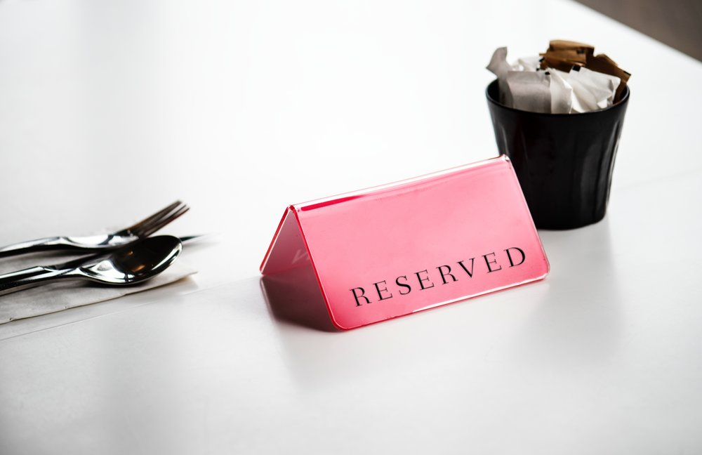 Red RESERVED Sign on Table - place setting.jpg