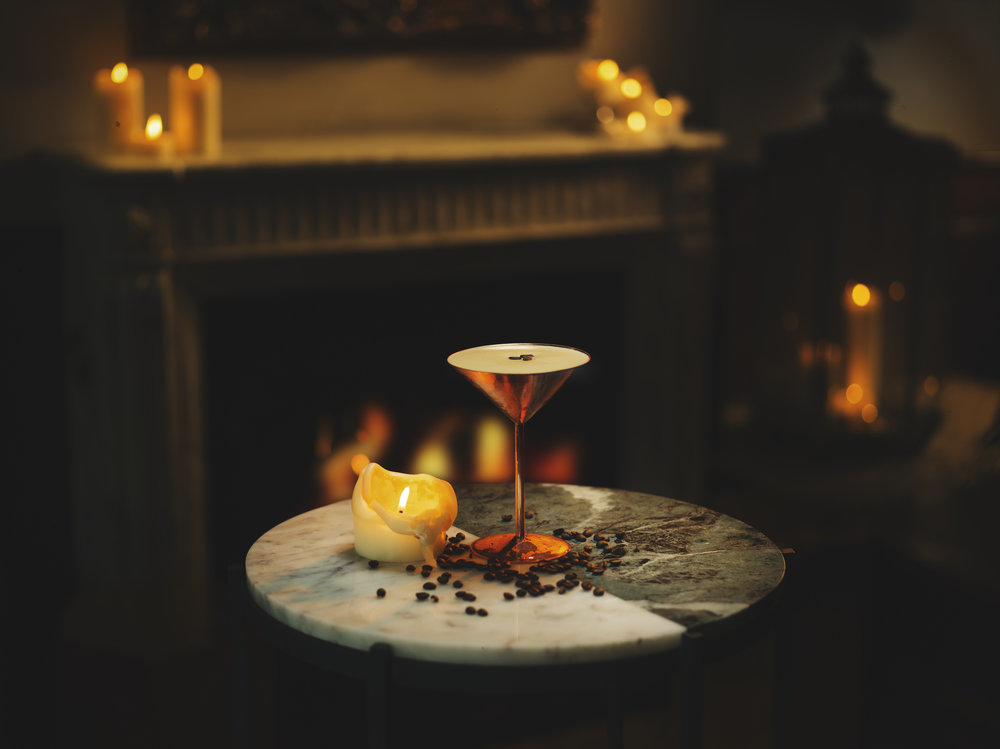 espresso martini, still life cocktail drink shoot. advertising, packshot, candlelit and cosy. lifestyle campaign images with atmosphere. Whisky, vodka, coffee, interior shots.