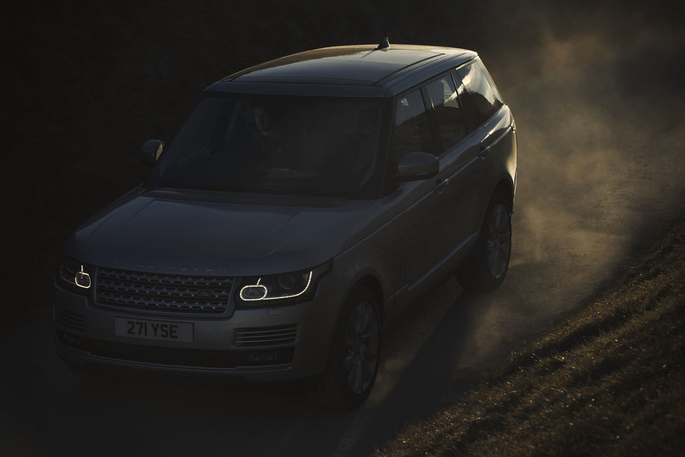 Range Rover  drives into sunset in Commercial advertising automotive photography shoot.  off road in the Sussex for Land Rover. Packshot. Highlighting the Great British Outdoors, craftmanship, rural life and heritage brands. food photography still life.
