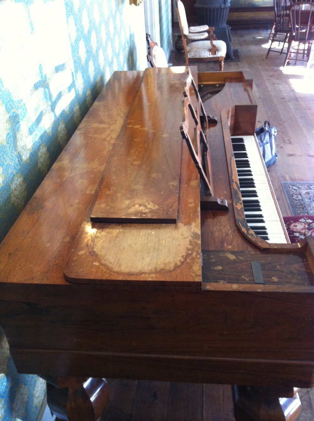 BEFORE - Historic Toscano Hotel piano