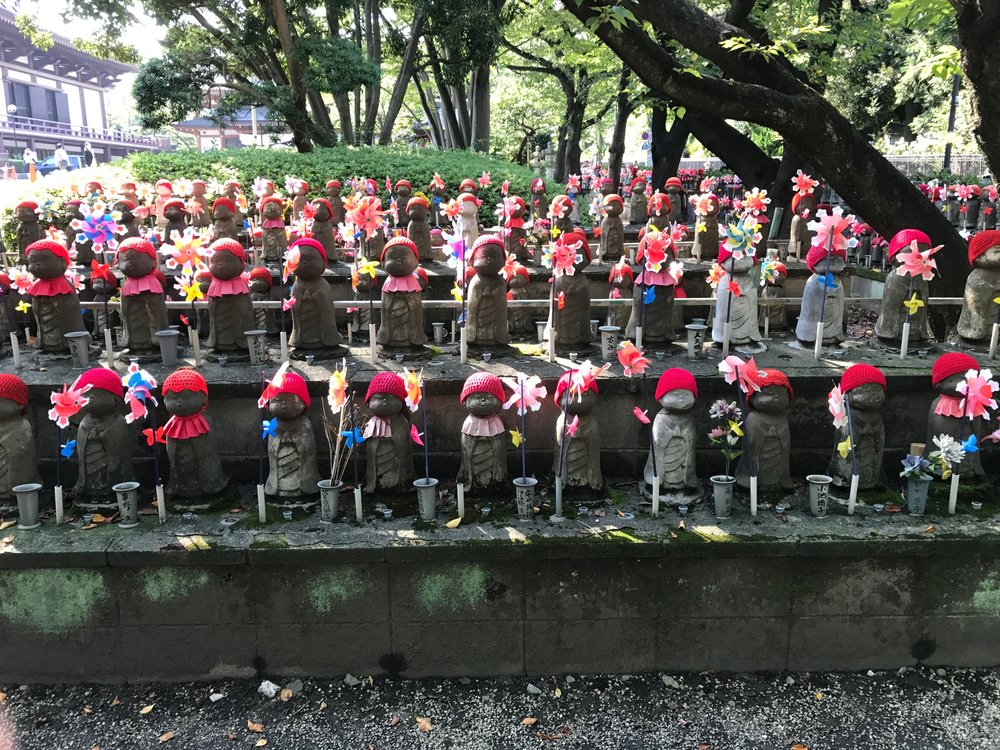 Jizo statues at the Zojo-ji Buddhist Temple in the Shiba area of Minato, Tokyo, Japan.