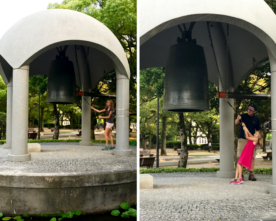 Autumn (left) and Eden (with the help of her Daddy on the right) ring the Bell of Peace.
