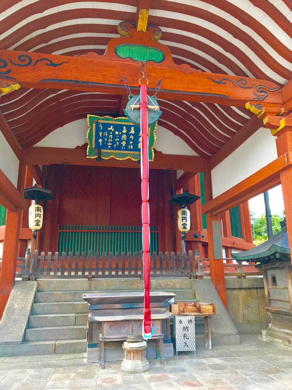 Pilgrims ring the bell here (attached to the long red rope) at Kofokuji Temple in Japan to alert the gods of their presence.