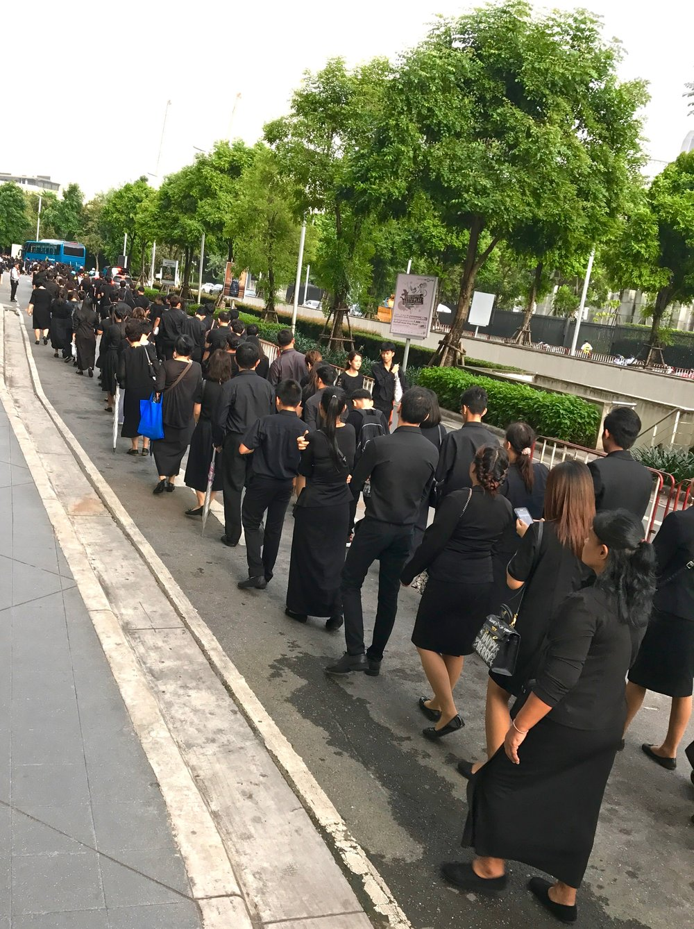 Thousands of Thai mourners line up here in the Ratchaprasong District for the opportunity to offer sandalwood flowers in homage to the king.