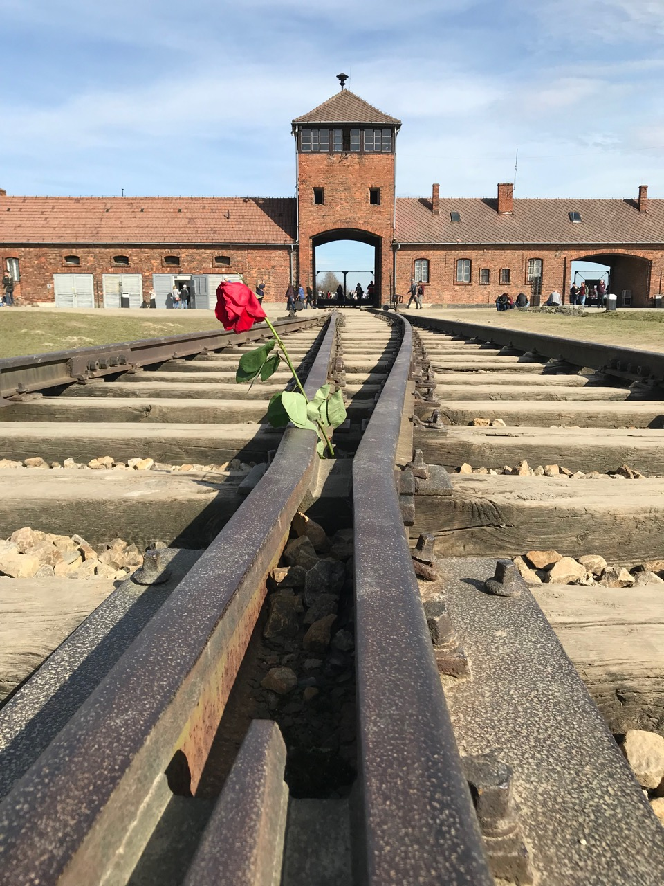 A view of the entrance gate from inside Birkenau on the tracks leading to the crematorium