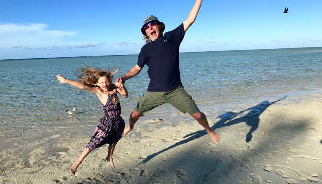 Mitchell & Eden leaping on the beach on  Heron Island  at The Great Barrier Reef in Australia.