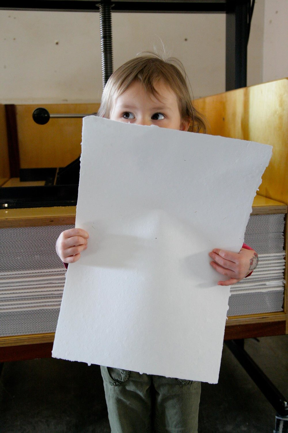 A little too short to hold such a big sheet of paper!