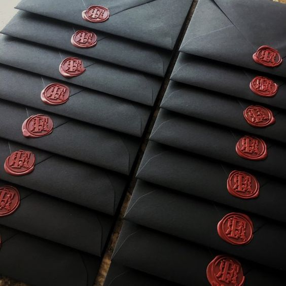 Black Envelope with Red Wax Seal.jpg