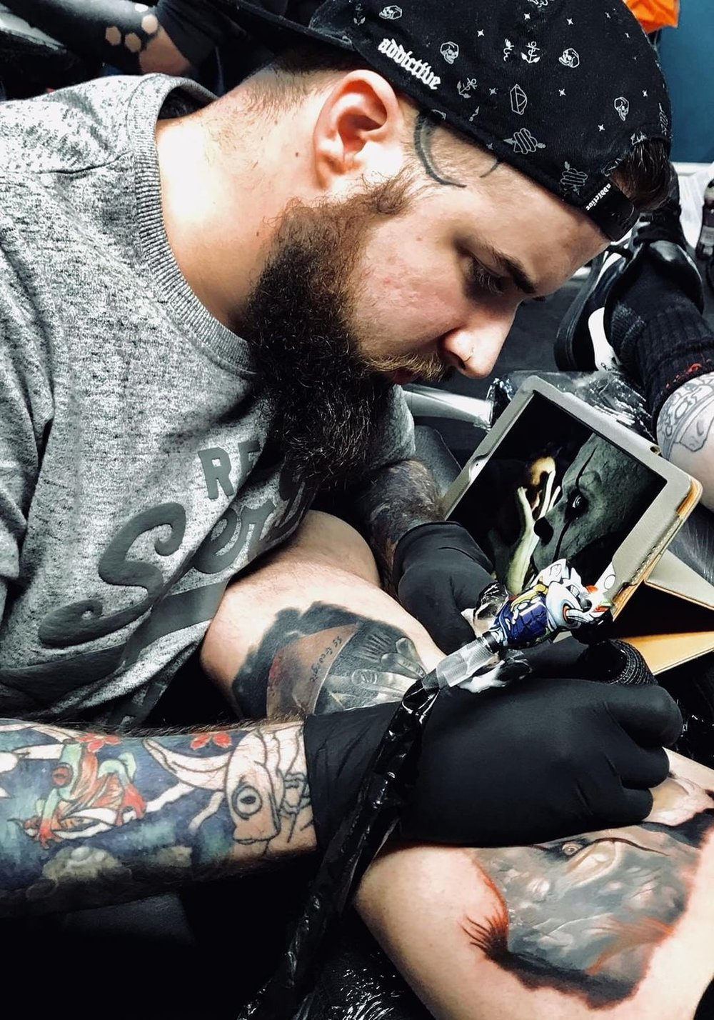 Simon Barraclough - Simon Specializes in black and gray realism and horror tattoos. He has been tattooing for 6 years and has his own studio Shipwrecked Tattoo. Click on his picture to see his portfolio!!