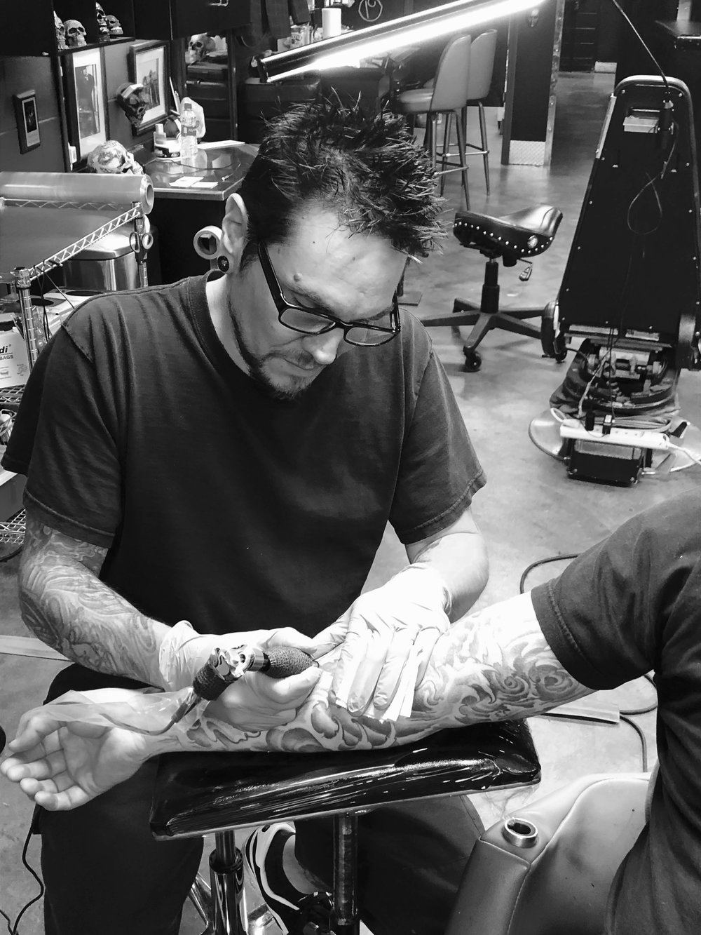 David Sherwood - David specializes in black and gray portraits and macabre style work but is also versatile in many other styles of tattooing. Click on his picture to check out some of his work!
