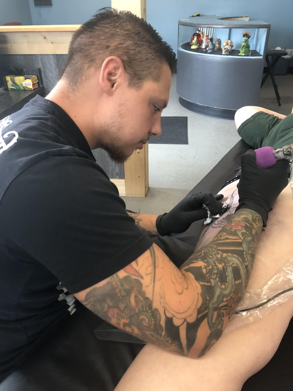 Bryon McVaney - Bryon is a versatile artist who loves doing all styles. He prefers mostly black and grey but really likes working with color as well. Click on his picture to see his work!