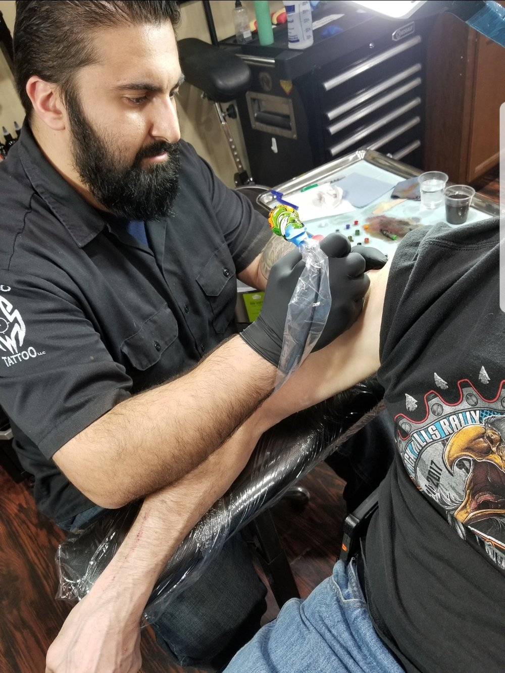 Paul Abraham - Paul has been tattooing since 2014. He enjoys tattooing all styles from realism to American traditional. Click his photo to check out his work!