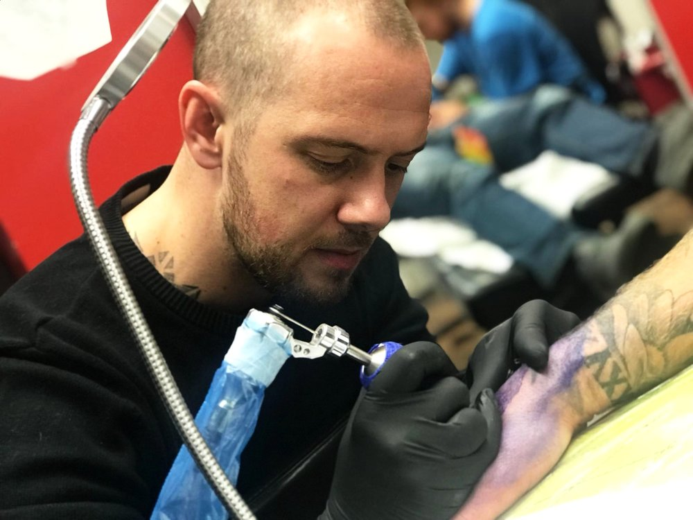 Jason Gray - Jason is a 2nd generation tattooist in his 11th year working professionally. He enjoys black and grey realism and Japanese styles but prides himself on tattooing anything that walks through the door. Jason stays busy working conventions year round and have won awards for his oriental work. Click his picture to check out his work!
