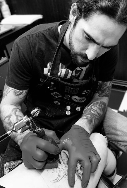 Michael Moscoso - Michael has been tattooing for 10 years. He tattoos a little bit of everything but his primary focus is on dark black and grey. Click his photo to check out his work!
