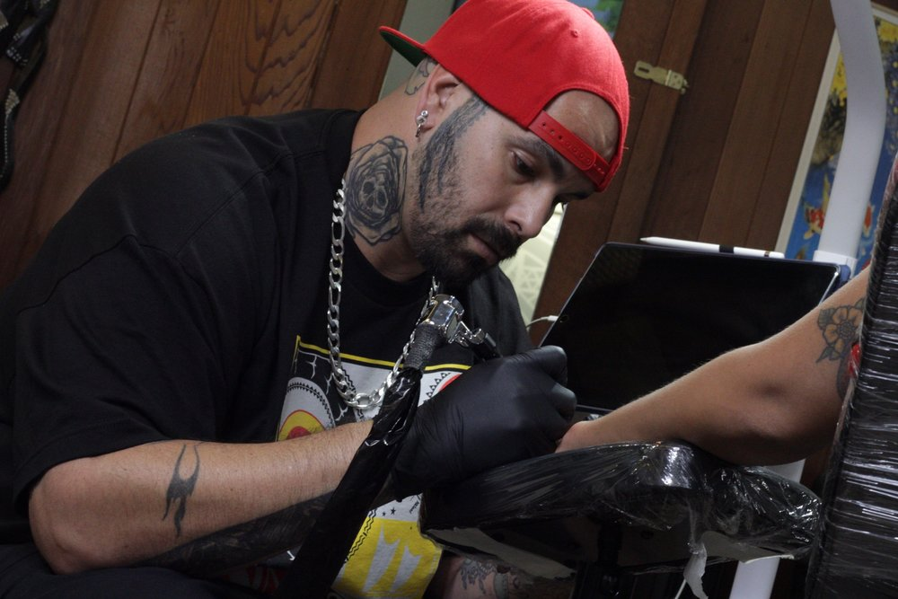 Justin Maldonado - Justin is a free hand Polynesian/ black and grey artist. He's a well rounded artist, tattooing all styles of tattoos. Click his photo to check out his work!