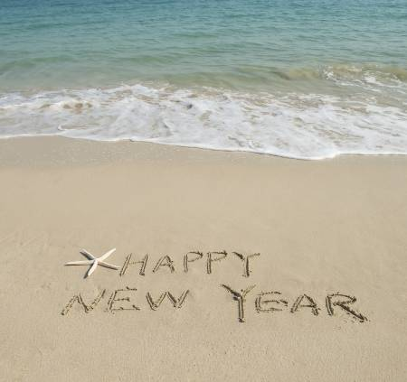 24872011-happy-new-year-written-in-the-sand.jpg