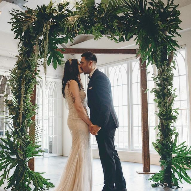 Indoor tropical oasis wedding archway by us.... 🌿 @moonflower__artistry  This four-posted porch arbour was salvaged from an old country homestead that held the love in its home for 120 years. Nowadays it's feeling the love of all our gorgeous brides & grooms.... 🌿🌿🌿 #weddingarchway #sydneywedding #destinationwedding #sydneyweddingstylist #tropicalluxe #indoorwedding #archway #iloveyou #weddingday #weddingdress #vintagetattoo