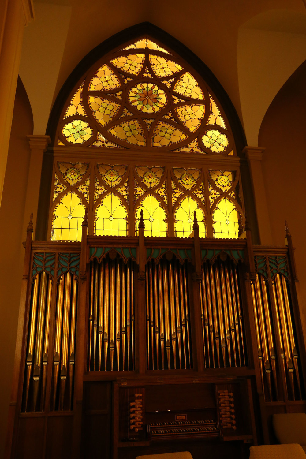 The stained glass at the front of the sanctuary above the organ.