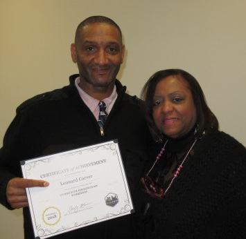 Leonard on graduation day with his instructor, Deborah Smith.