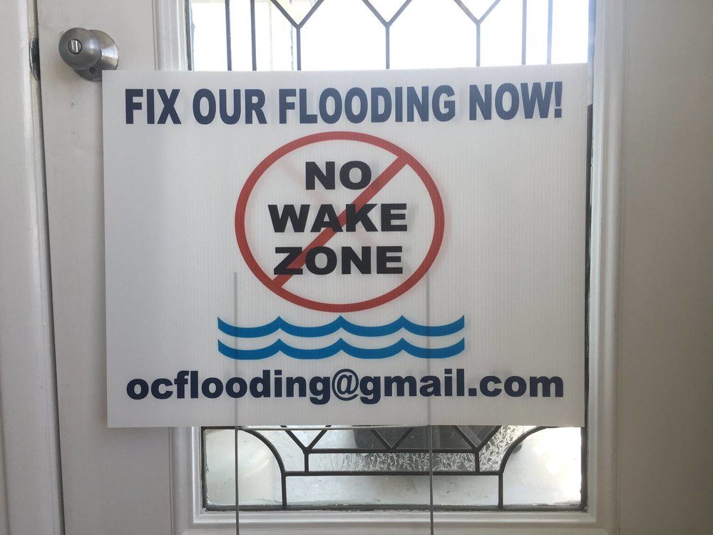 A sign from the Food Group, 'Ocean City, NJ Flooding'.